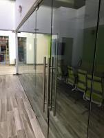 "Glass-enclosed conference room (1/2"" clear glass)."