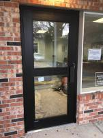Wide-stile commercial entry door with an intermediate horizontal.