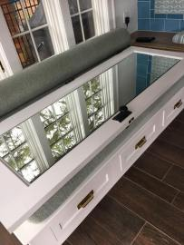 Polished-edge mirror mounted to an interior door.