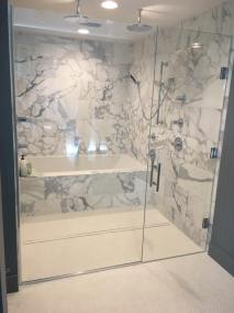Door & panel enclosing a client's shower/bathtub area.