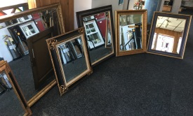Beveled mirrors installed in antique frames.