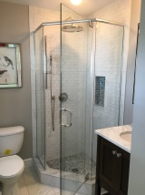 "Neo-angle ""frameless"" shower enclosure with 3/8"" clear glass."
