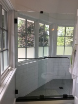 """Essence"" sliding shower enclosure with 1/2"" low-iron / ""ultrawhite"" glass."