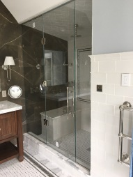 "Panel-door-panel steam shower enclosure with 1/2"" low-iron/ ""ultrawhite"" glass with Showerguard coating."