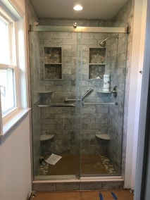 """Gemini Plus"" frameless bypass sliding shower door system."