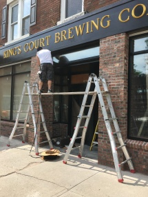Putting the finishing touches on a storefront in Poughkeepsie.