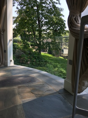 Bent glass railing installed around a client's outdoor living area.