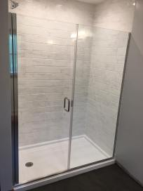 """Uptown Grand"" semi-frameless shower enclosure."