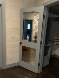 """1/4"""" mirrors with polished edges installed on the back of a closet door."""