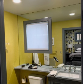 The client requested that this wall be covered with a single mirror (no seams) - after some careful measurements and calculations (the walls were slightly out-of-square), we were able to fulfill her request and install this mirror with a large cutout for the window (as well as a smaller cutout for the outlet).