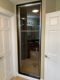 Semi-frameless door for a steam shower.