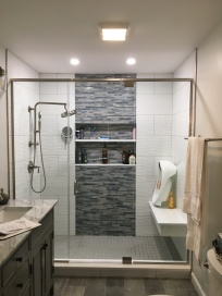 Panel-door-panel shower enclosure with a header.